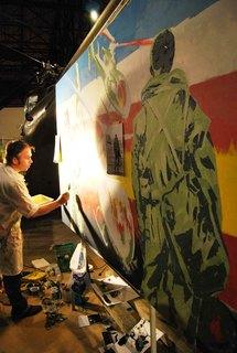 L'artiste Vincent Feys en action lors de la soirée franco-allemande